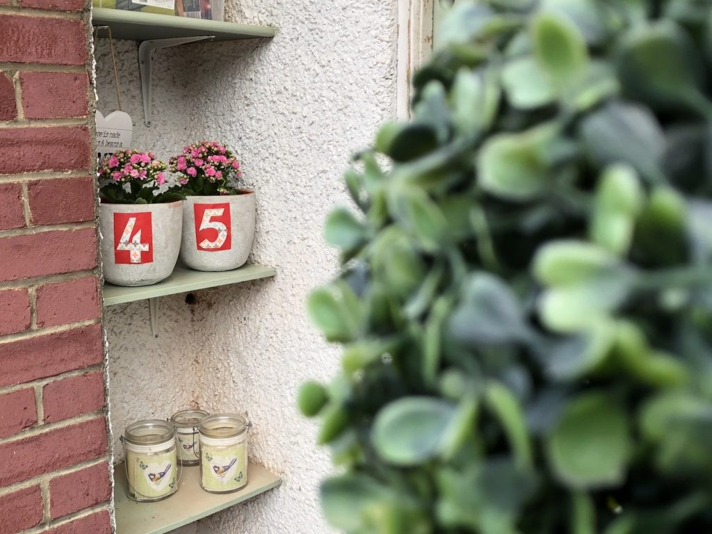 Plant pot door numbers